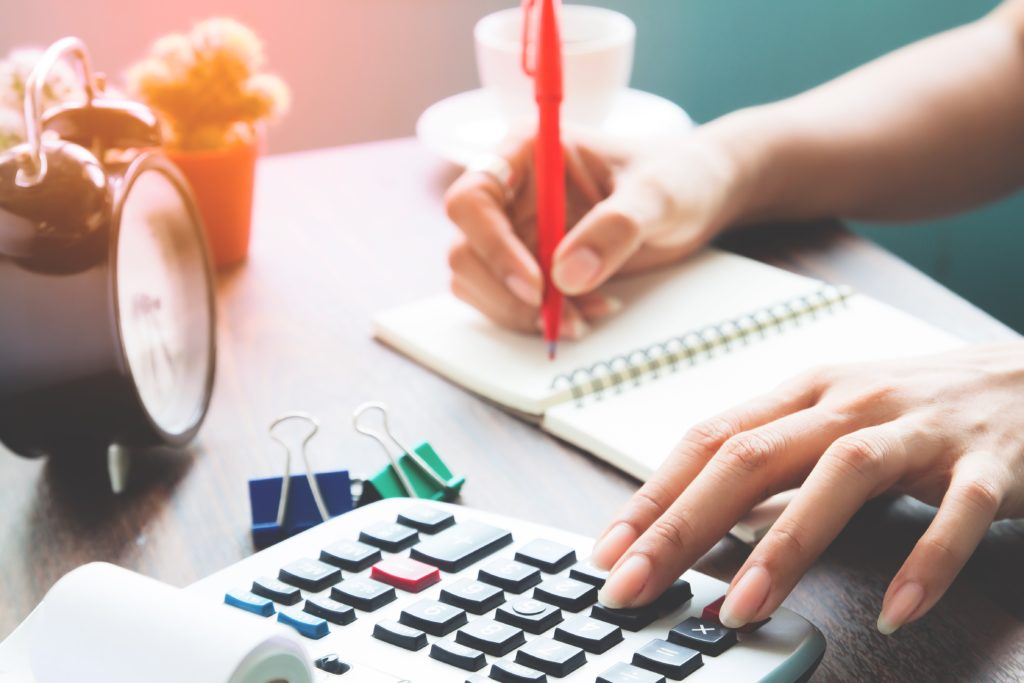 Accounting concept, Working woman using calculator